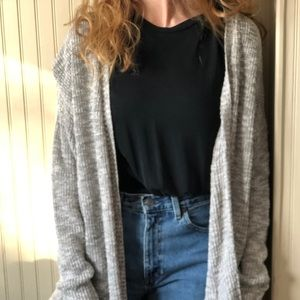 a comfy long grey cardigan
